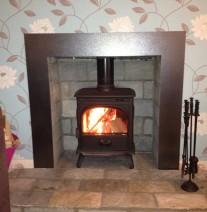 Installed wood burner with modern surround