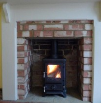 Hobbit stove in a small fireplace