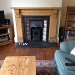Victorian fireplace with wood burning stove