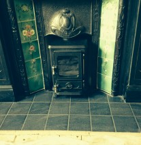 Small stove in existing surround