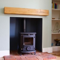 AGA wood burning stove installed on brick hearth